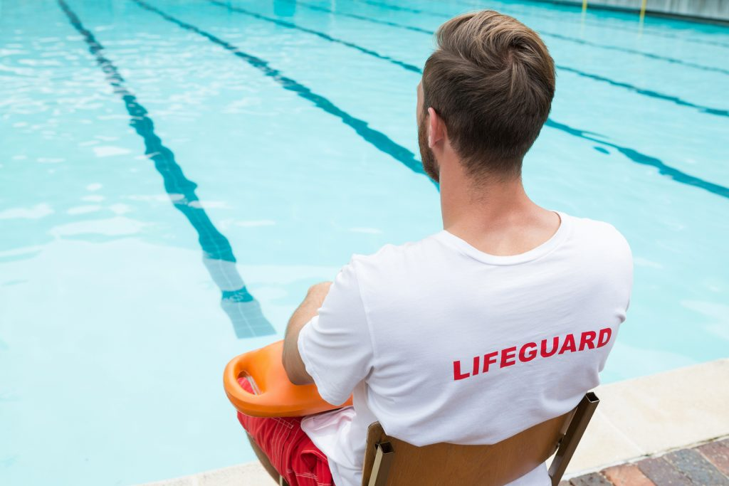 bigstock-rear-view-of-lifeguard-sitting-184572139-1024x683