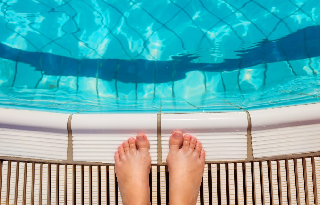feet-at-the-swimming-pool-pwrb4rf-scaled-1024x655
