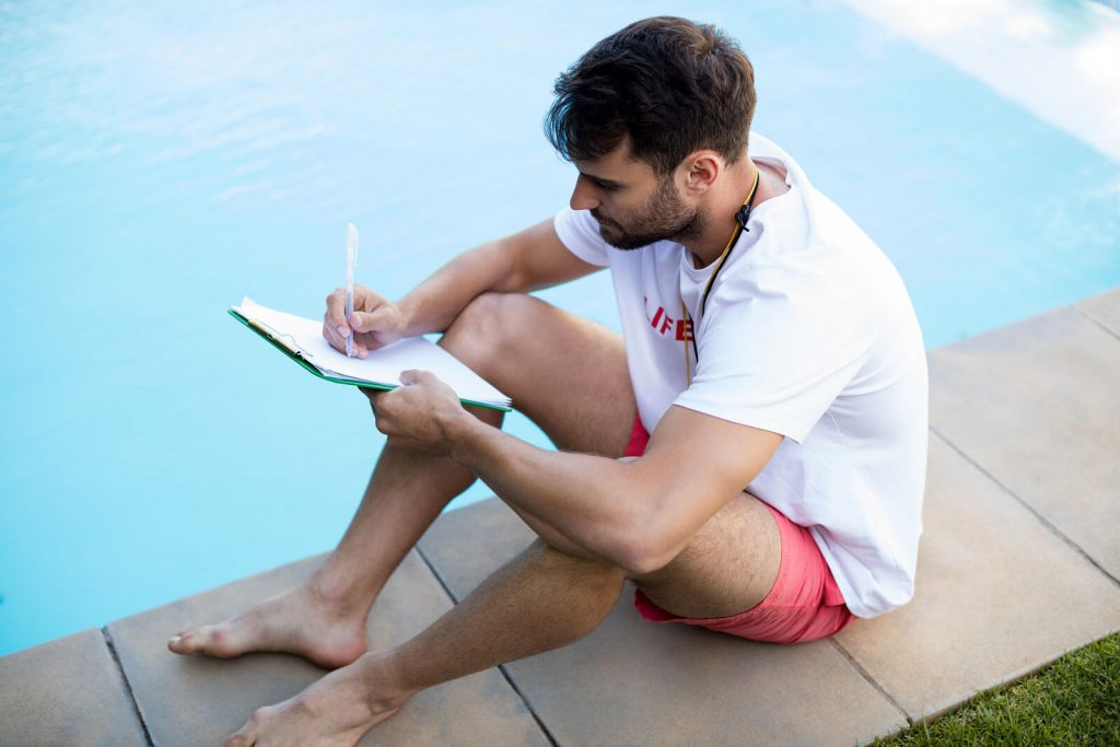 bigstock-lifeguard-writing-on-clipboard-184538887-1-1024x683