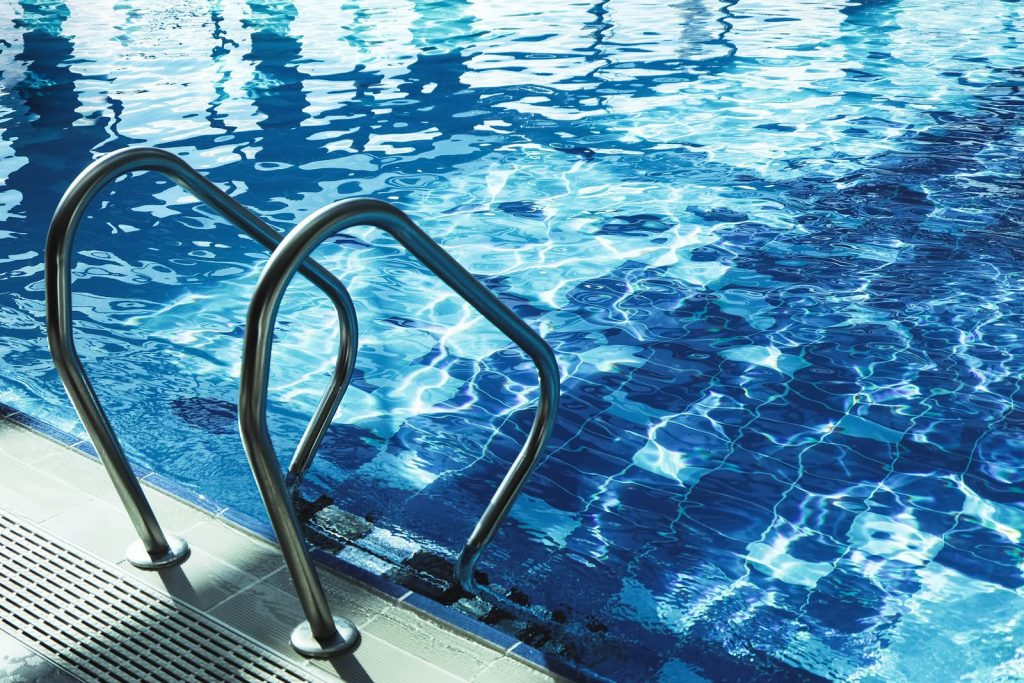 bigstock-swimming-pool-metal-staircase-232680196-1024x683