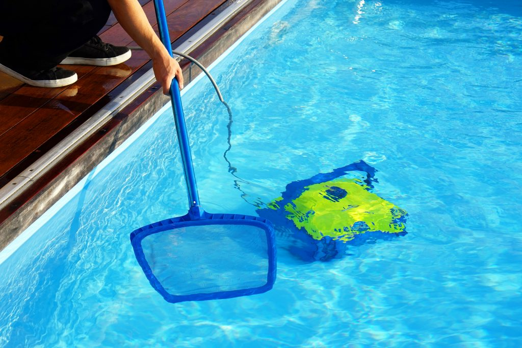 bigstock-pool-cleaner-during-his-work-238420558-1024x683