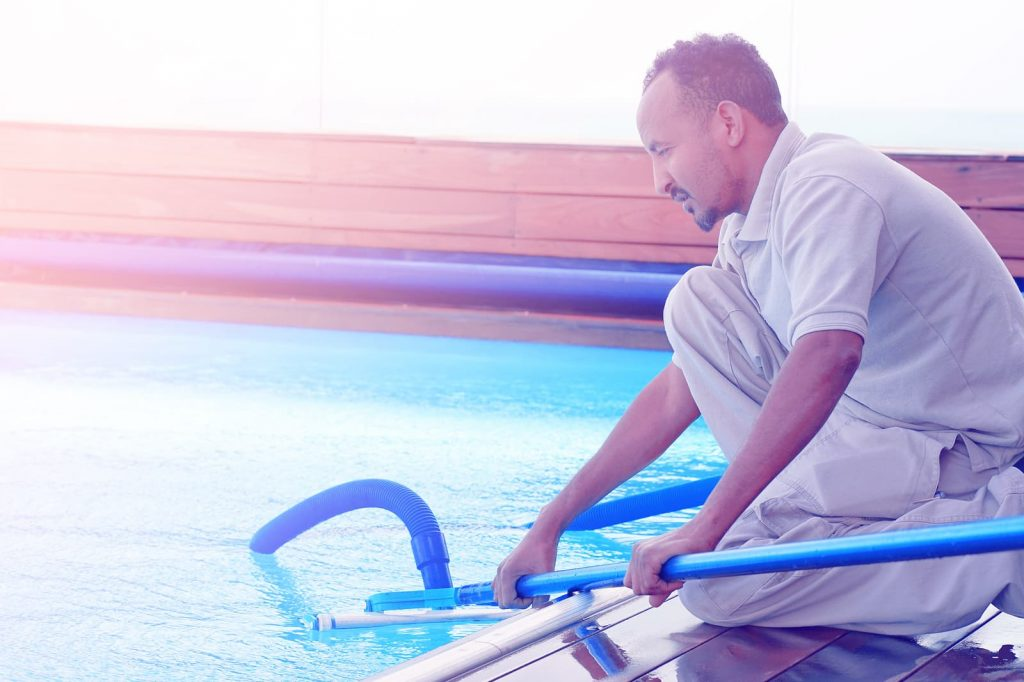 bigstock-pool-cleaner-during-his-work-249174202-1024x682
