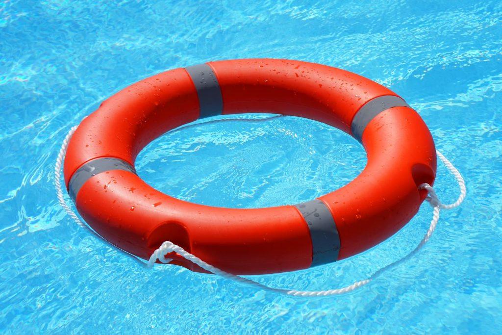 bigstock-red-lifebuoy-pool-ring-float-o-267267739-1024x683