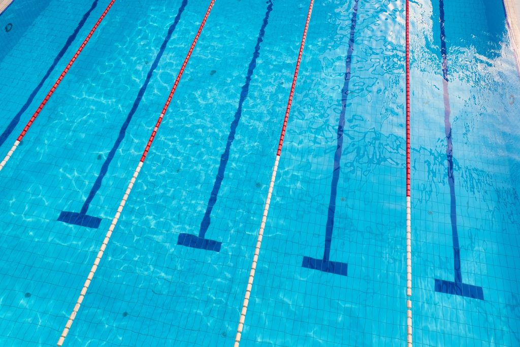 bigstock-swimming-pool-with-empty-lanes-256597519-1024x683