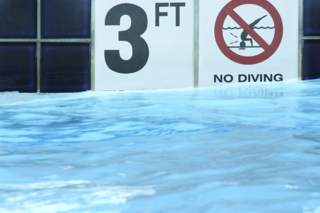 bigstock-feet-and-no-diving-sign-on-p-2480499-1024x683
