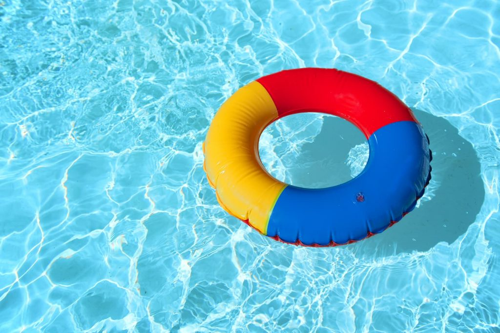 bigstock-swimming-pool-with-floatable-t-15628721-1024x682