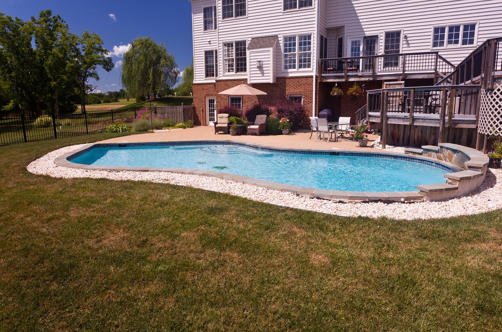 bigstock-backyard-swimming-pool-and-pat-21791915