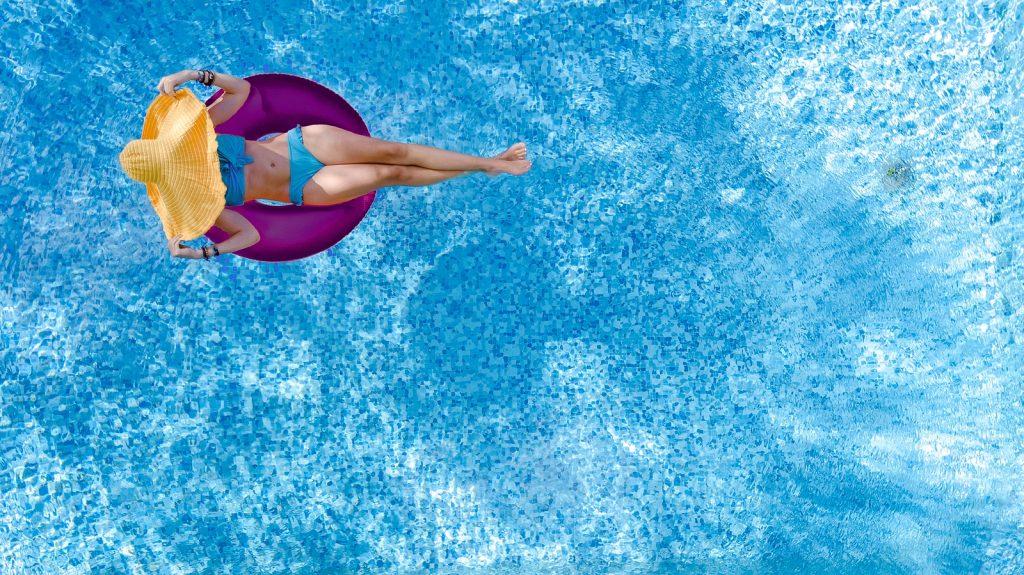 bigstock-beautiful-woman-in-hat-in-swim-356020310-1024x575