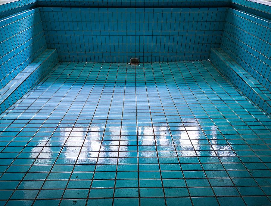 bigstock-empty-blue-swimming-pool-in-ol-372415141