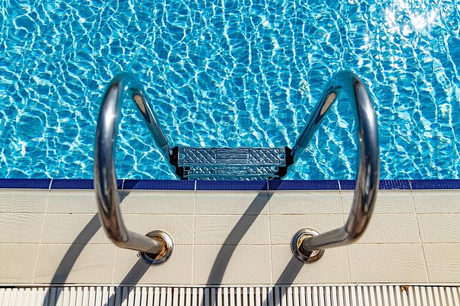 bigstock-grab-bars-ladder-in-the-swimmi-363991705