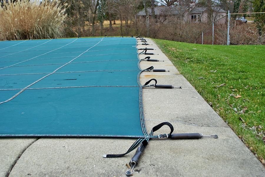 bigstock-backyard-swimming-pool-with-di-338939191